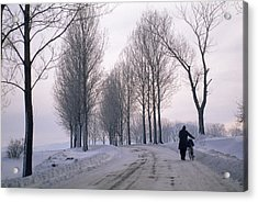 Pushing A Bike Along A Snow Covered Acrylic Print by Gordon Wiltsie