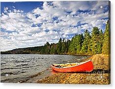 Red Canoe On Lake Shore Acrylic Print by Elena Elisseeva