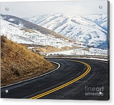 Road Through A Snowy Mountain Landscape Acrylic Print by Thom Gourley/Flatbread Images, LLC