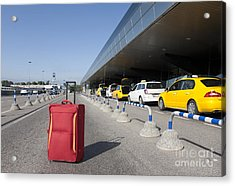 Rolling Luggage Outside An Airport Terminal Acrylic Print by Jaak Nilson