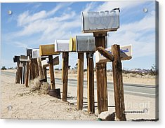 Row Of Mailboxes Along Desert Road Acrylic Print by Paul Edmondson