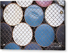Rows Of Stacked Barrels Behind A Fence Acrylic Print by Paul Edmondson