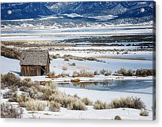 Rustic Barn In A Snowy Valley Next To A Pond Acrylic Print by C Thomas Willard
