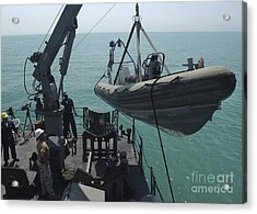 Sailors Lower A Rigid Hull Inflatable Acrylic Print by Stocktrek Images