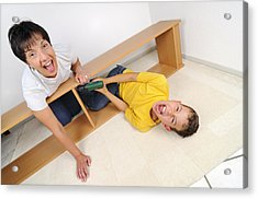 Screaming Mother And Son Assembling Furniture Acrylic Print by Matthias Hauser