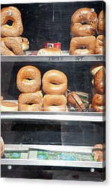 Selection Of Bagels On Shelves Behind A Shop Window Acrylic Print by Paul Hudson
