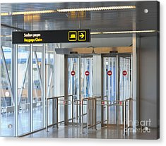 Sign Leading To Baggage Claim Acrylic Print by Jaak Nilson