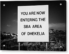 sign marking entrance of SBA Sovereign Base area of Dhekelia in the british controlled cyprus Acrylic Print by Joe Fox