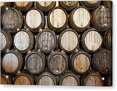 Stacked Oak Barrels In A Winery Acrylic Print by Marc Volk