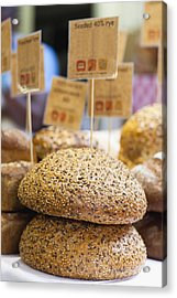 Stacks Of Fresh Bread For Sale Acrylic Print by Hybrid Images