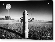 Stop Sign Against Blue Sky And Red Darling Valve Fire Hydrant In Rural Michigan North Dakota Usa Acrylic Print by Joe Fox
