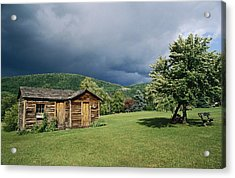Storm Clouds Form Above A Log Cabin Acrylic Print by Raymond Gehman