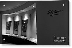 Acrylic Print featuring the photograph Telephones On Wall by Nina Prommer