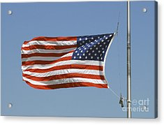 The American Flag Waves At Half-mast Acrylic Print by Stocktrek Images