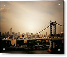 The New York City Skyline And Manhattan Bridge At Sunset Acrylic Print by Vivienne Gucwa