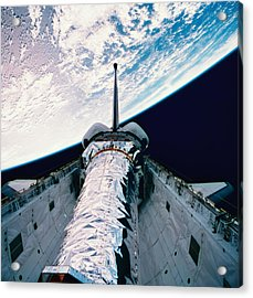 The Space Shuttle With Its Open Cargo Bay Orbiting Above The Earth Acrylic Print by Stockbyte