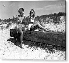 Two Women In Bikini Eating Snack On Beach, (b&w) Acrylic Print by George Marks