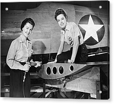 Two Women Working On Airplane Acrylic Print by George Marks