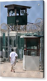 Under The Guard Tower A Detainee Walks Acrylic Print by Everett