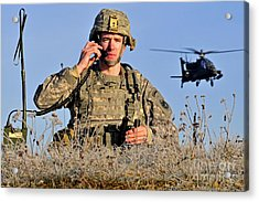 U.s. Army Captain Directs An Ah-64 Acrylic Print by Stocktrek Images
