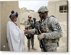 U.s. Army Soldier Shakes Hands With An Acrylic Print by Stocktrek Images
