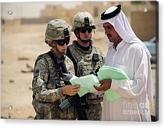 U.s. Army Soldiers Talking With A Town Acrylic Print by Stocktrek Images