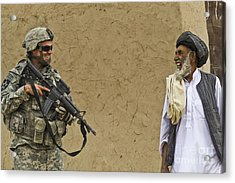 U.s. Army Specialist Talks To An Afghan Acrylic Print by Stocktrek Images