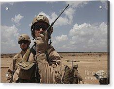 U.s. Marine Uses A Radio In Djibouti Acrylic Print by Stocktrek Images