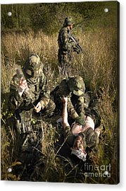 U.s. Navy Seals Give First Aid Acrylic Print by Tom Weber