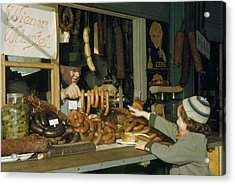 Vendor Holds Up Sausages For Young Girl Acrylic Print by Volkmar Wentzel