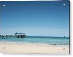 View Of A Pier From A Sandy Beach Acrylic Print by Caspar Benson
