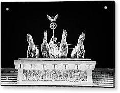 viktoria with quadriga on top of the Brandenburg gate at night Berlin Germany Acrylic Print by Joe Fox