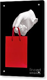 White Glove Holding A Red Gift Bag Acrylic Print by Richard Thomas