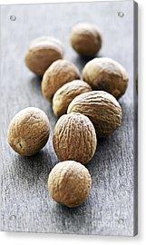 Whole Nutmeg Seeds Acrylic Print by Elena Elisseeva