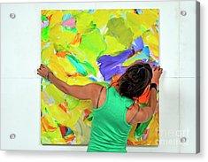Woman Adjusting A Painting Acrylic Print by Sami Sarkis