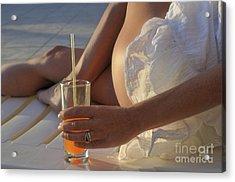 Woman Holding Cocktail Glass While Sunbathing Acrylic Print by Sami Sarkis