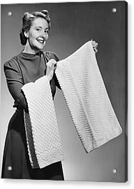 Woman Holding Up Towels Acrylic Print by George Marks