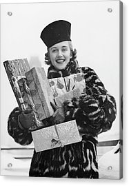 Woman In Fur Coat Holding Christmas Gifts Acrylic Print by George Marks