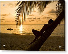 Woman Resting On A Palm Tree At Sunset Acrylic Print by Richard Nowitz