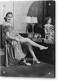 Woman Sitting At Vanity Table, Putting On Stockings, (b&w), Portrait Acrylic Print by George Marks