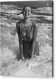 Woman Standing In Surf At Beach Acrylic Print by George Marks