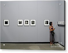 Woman Watching Photos At Exhibition Acrylic Print by Sami Sarkis