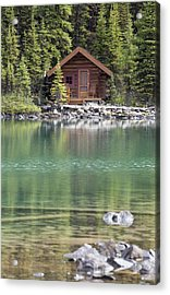Wooden Cabin Along A Lake Shore Acrylic Print by Michael Interisano