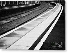 Yellow Warning Line And Textured Contoured Tiles Railway Station Platform And Track Northern Ireland Acrylic Print by Joe Fox