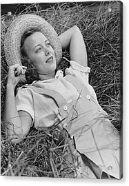 Young Woman Laying In Hay Thinking Acrylic Print by George Marks