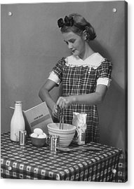 Young Woman Preparing Food Acrylic Print by George Marks