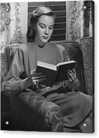 Young Woman Sitting On Sofa, Reading Book, (b&w) Acrylic Print by George Marks