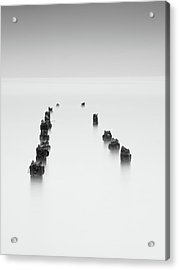 Acrylic Print featuring the photograph Damaged Wooden Poles Of An Old Pier In The Ocean. by Michalakis Ppalis