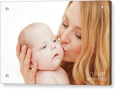 Mother Holding And Kissing Her Newborn Baby. Motherhood Acrylic Print