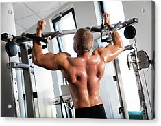 Muscular Strong Man Working Out At A Gym. Acrylic Print